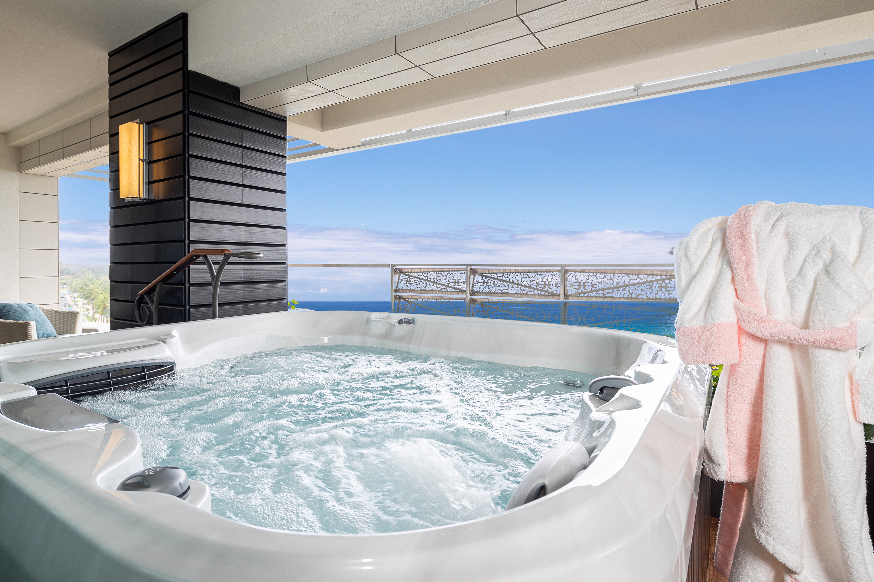 Jacuzzi on balcony with ocean views